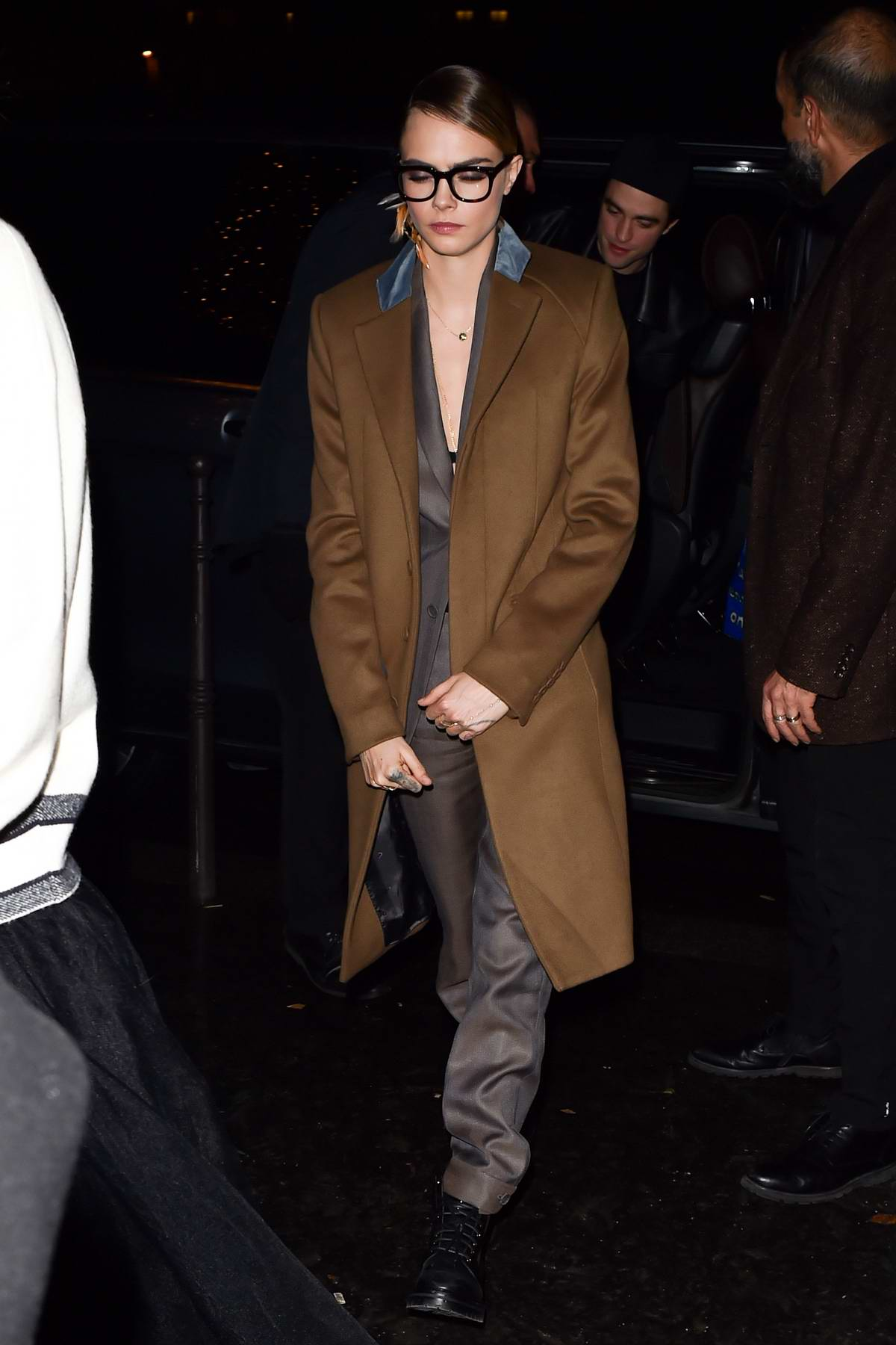 Cara Delevingne and Robert Pattinson seen arriving at Cavier Kaspier restaurant in Paris, France