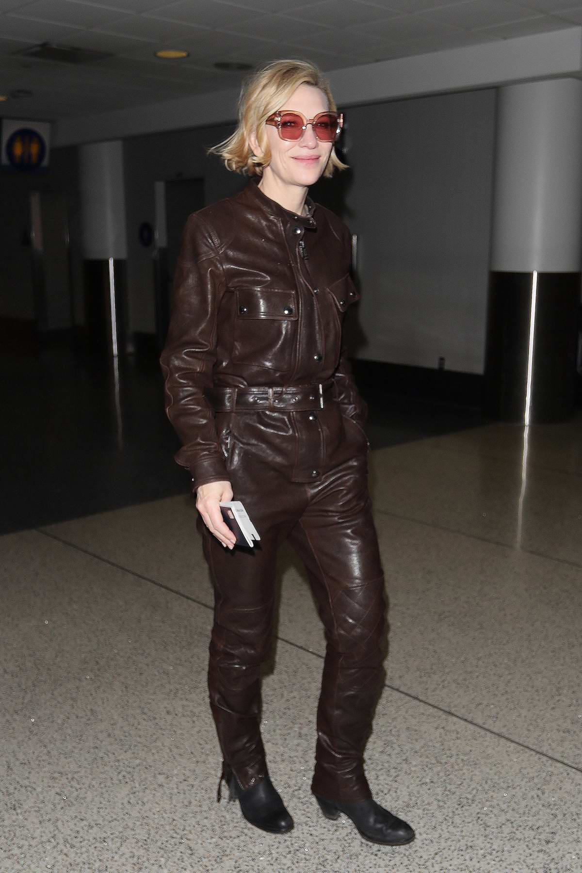 Cate Blanchett wears a brown leather jumpsuit as she arrives at LAX Airport in Los Angeles