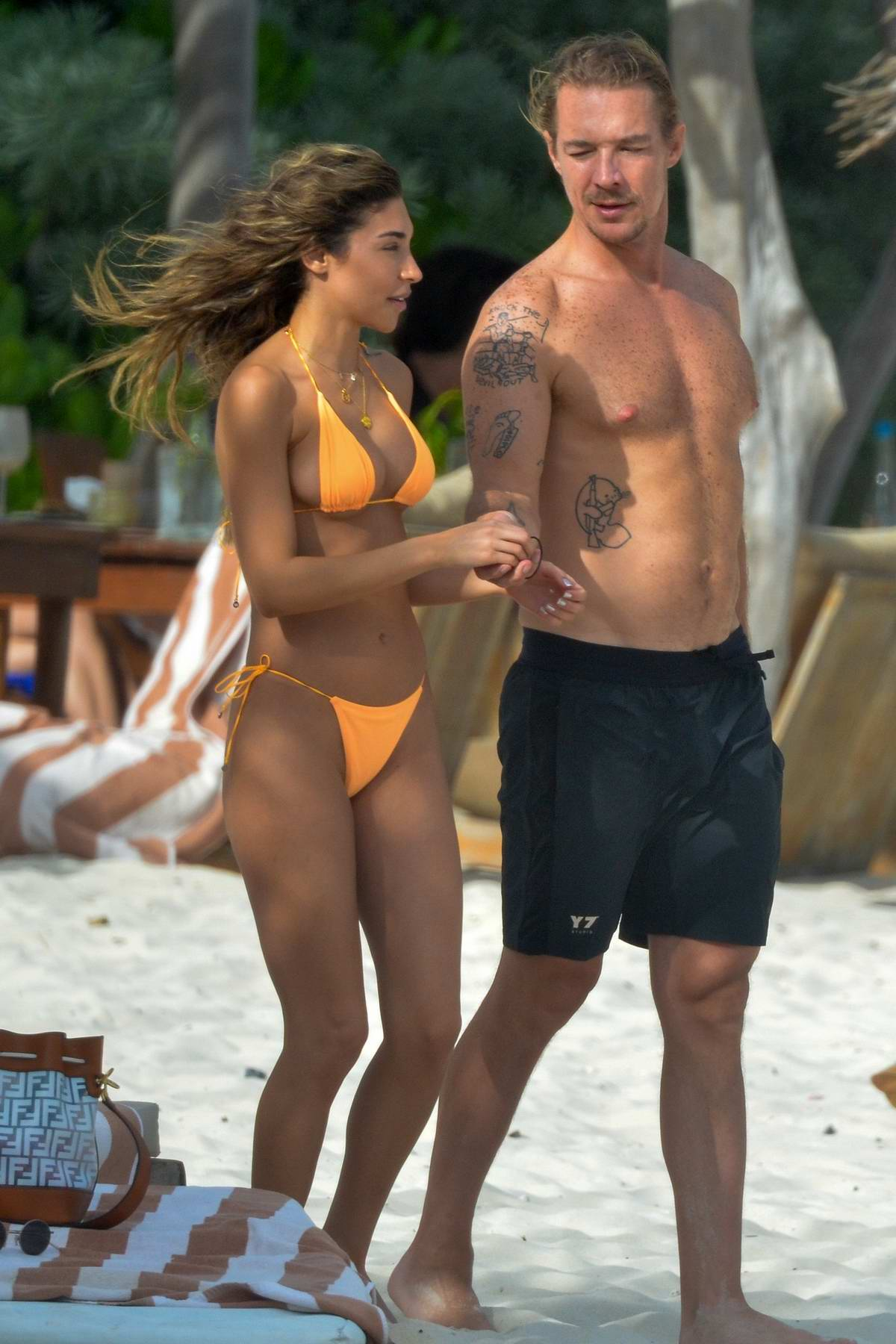 Chantel Jeffries sports an orange bikini as she enjoys a dip in the ocean with Diplo in Tulum, Mexico