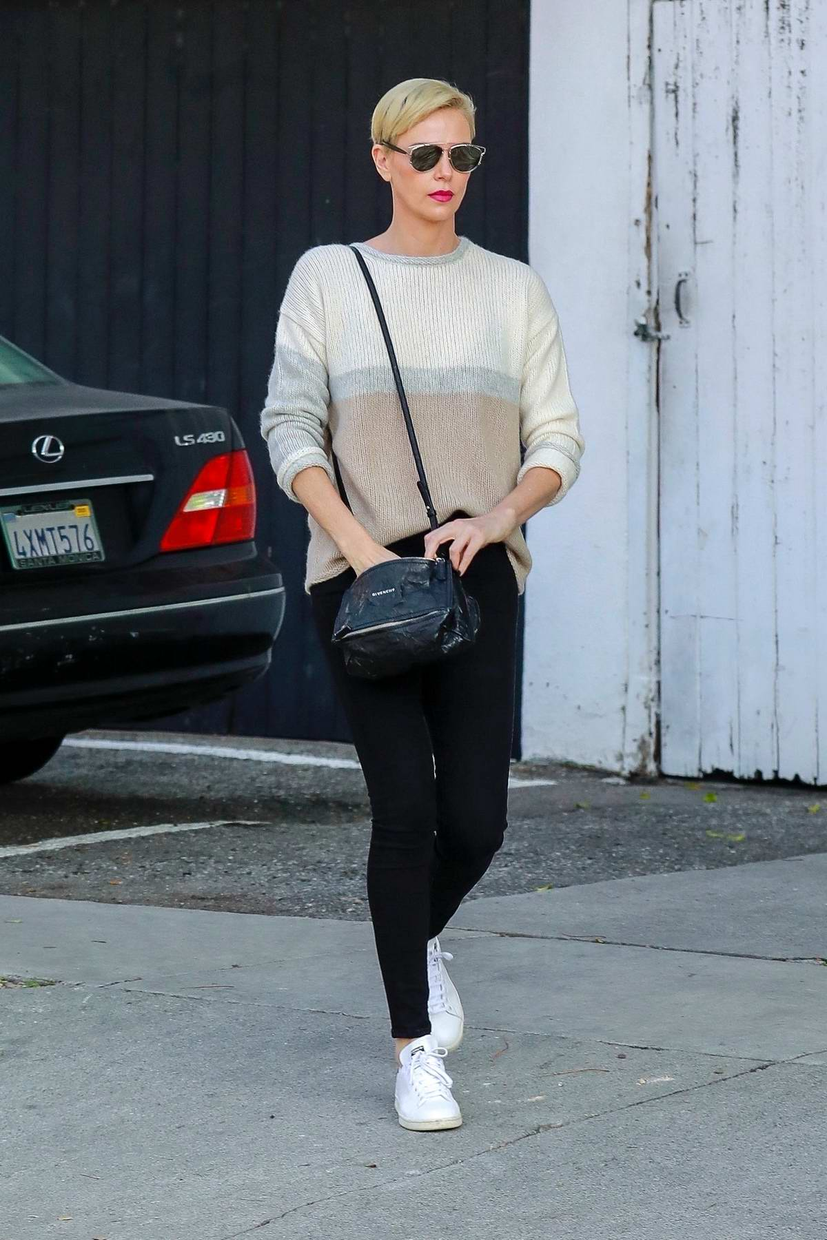 Charlize Theron looks slick in a sweater and skinny jeans while making trip to a furniture store in Los Angeles