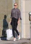 Charlize Theron wears a striped shirt and black skinny jeans as she steps out for some shopping in Hollywood, California
