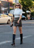Charlotte McKinney shows off her long legs in snakeskin mini skirt as she steps out in Beverly Hills, California