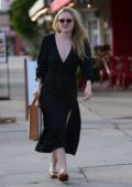 Dakota Fanning looks pretty in a black polka dot dress while out shopping in Los Angeles