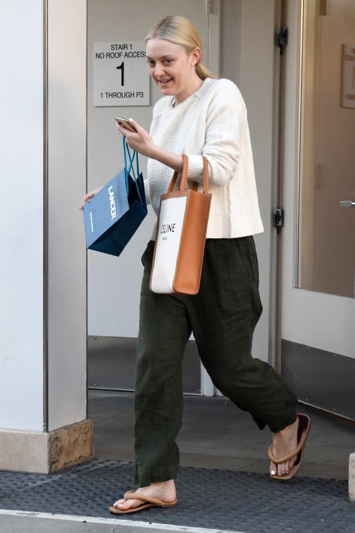 Dakota Fanning makes a stop at Lancer Dermatology before shopping on Rodeo Drive in Beverly Hills, California