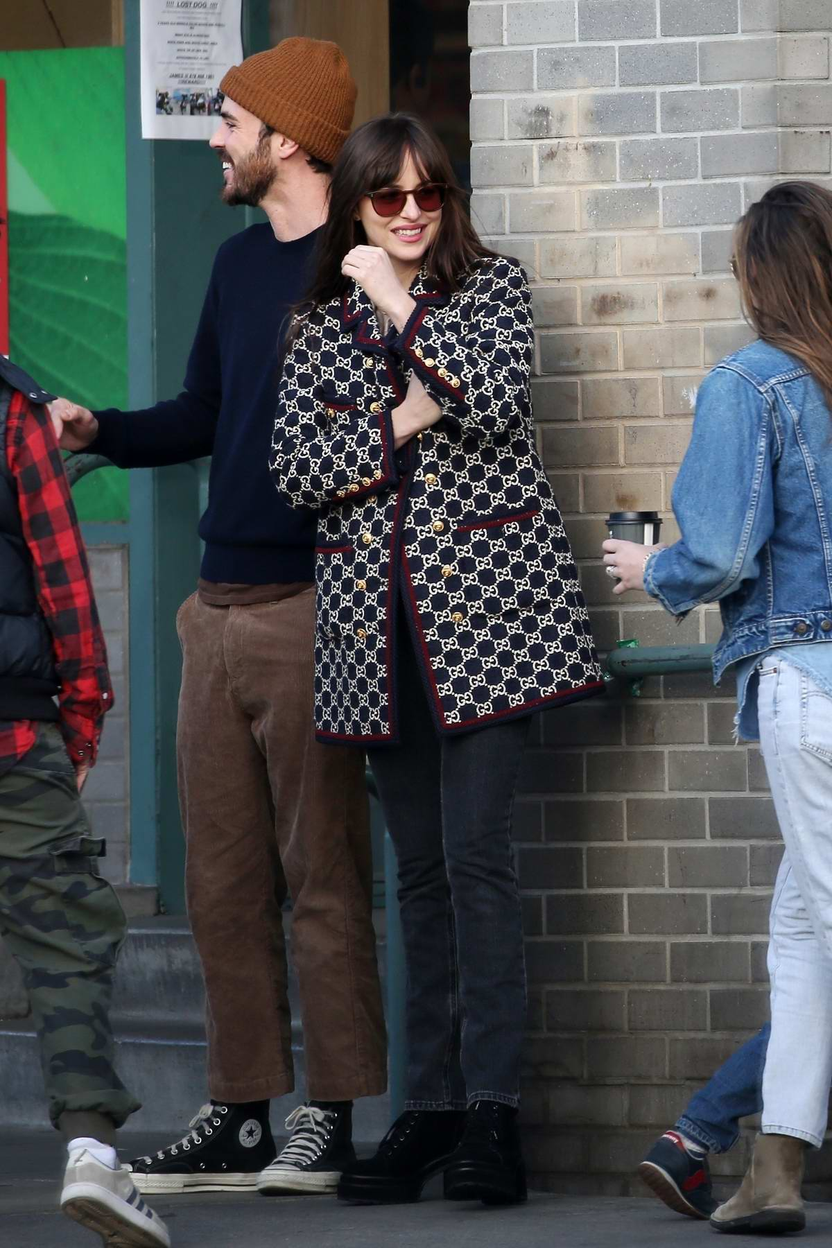 Dakota Johnson meets up with Busy Philipps after buying new sunglasses at Larchmont Village in Los Angeles