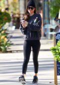 Dakota Johnson shows off her toned legs in black leggings as she leaves her yoga session in Studio City, California