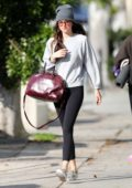 Dakota Johnson sports black leggings with a grey sweatshirt and beanie as she leaves a hot yoga class in Los Angeles