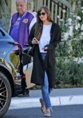 Dakota Johnson tips the valet after a lunch meeting at the San Vicente Bungalows in West Hollywood, California