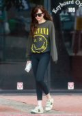 Dakota Johnson wears 'Nirvana' sweatshirt, leggings and Gucci sneakers as she leaves a yoga session in Studio City, California