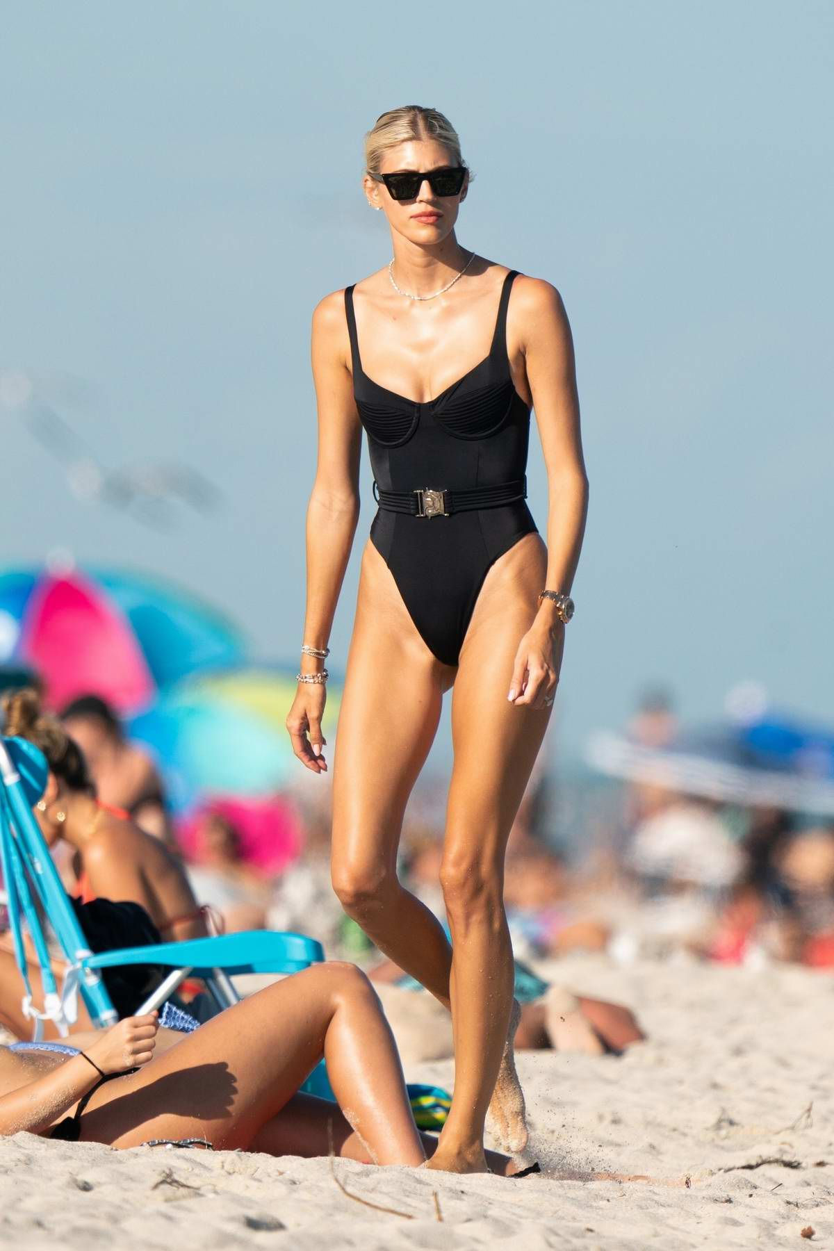 Devon Windsor shows off her model figure in a black swimsuit while enjoying a beach day in Miami, Florida