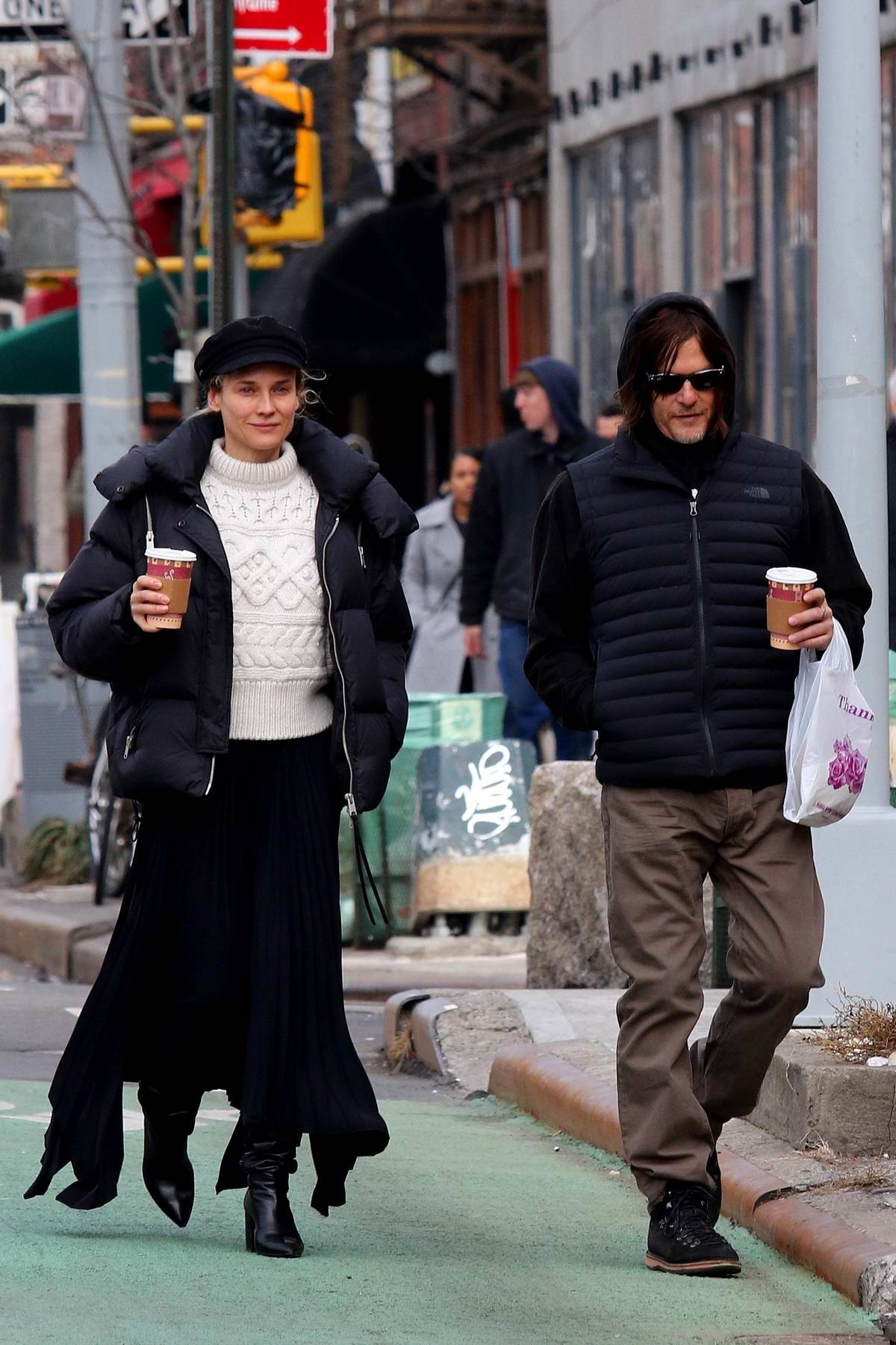 Diane Kruger and Norman Reedus go for a morning coffee run in Manhattan's West Village area, New York City
