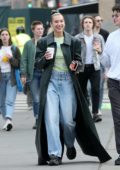 Dua Lipa is all smiles while out wearing a leather duster coat in New York City