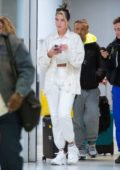 Dua Lipa rocks all-white ensemble as she arrives at JFK airport in New York City