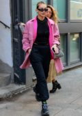 Dua Lipa stands out in a pink jacket as she steps out for the afternoon in New York City