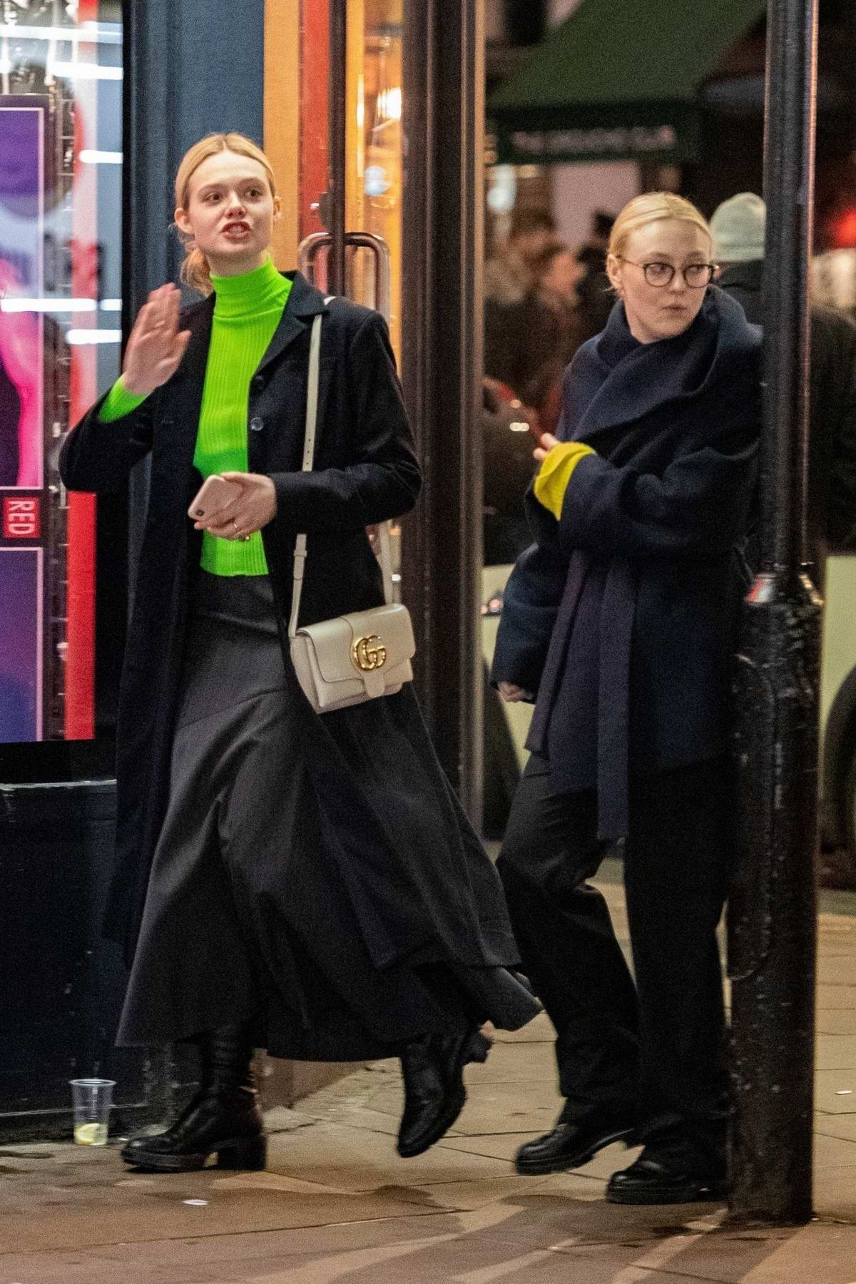 Elle Fanning and Dakota Fanning seen out and about with their mother in London, UK