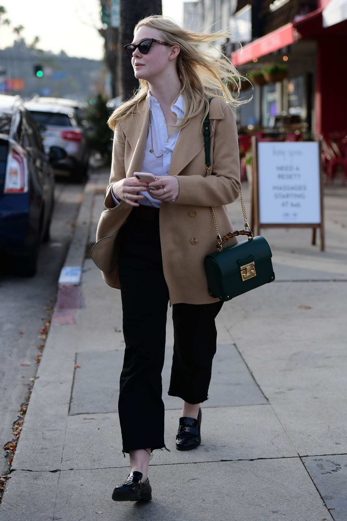 Elle Fanning catches a Rideshare after doing some shopping with sister Dakota Fanning in Los Angeles