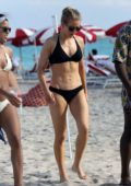 Ellie Goulding sports a black bikini while enjoying a day at the beach in Miami Beach, Florida