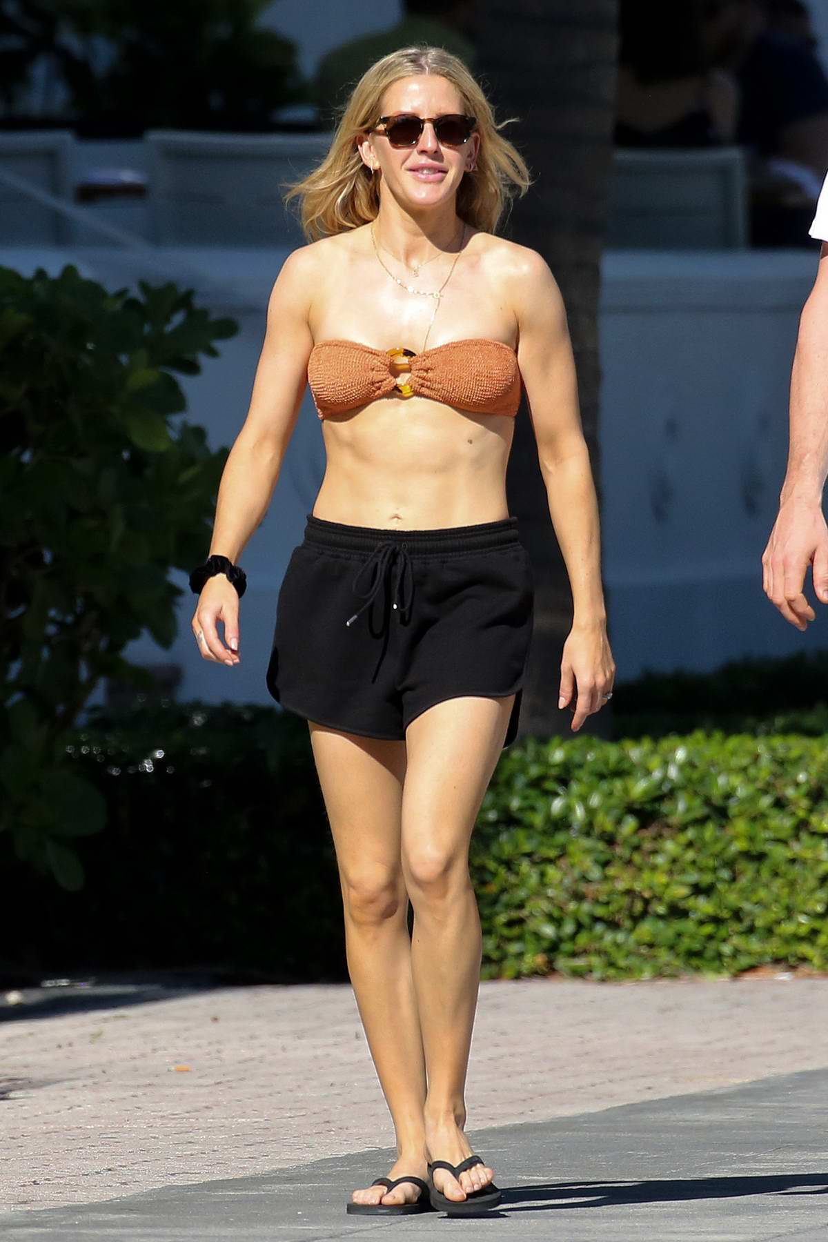 Ellie Goulding wears a bandeau bikini top and shorts as she takes a walk with husband Casper Jopling in Miami, Florida
