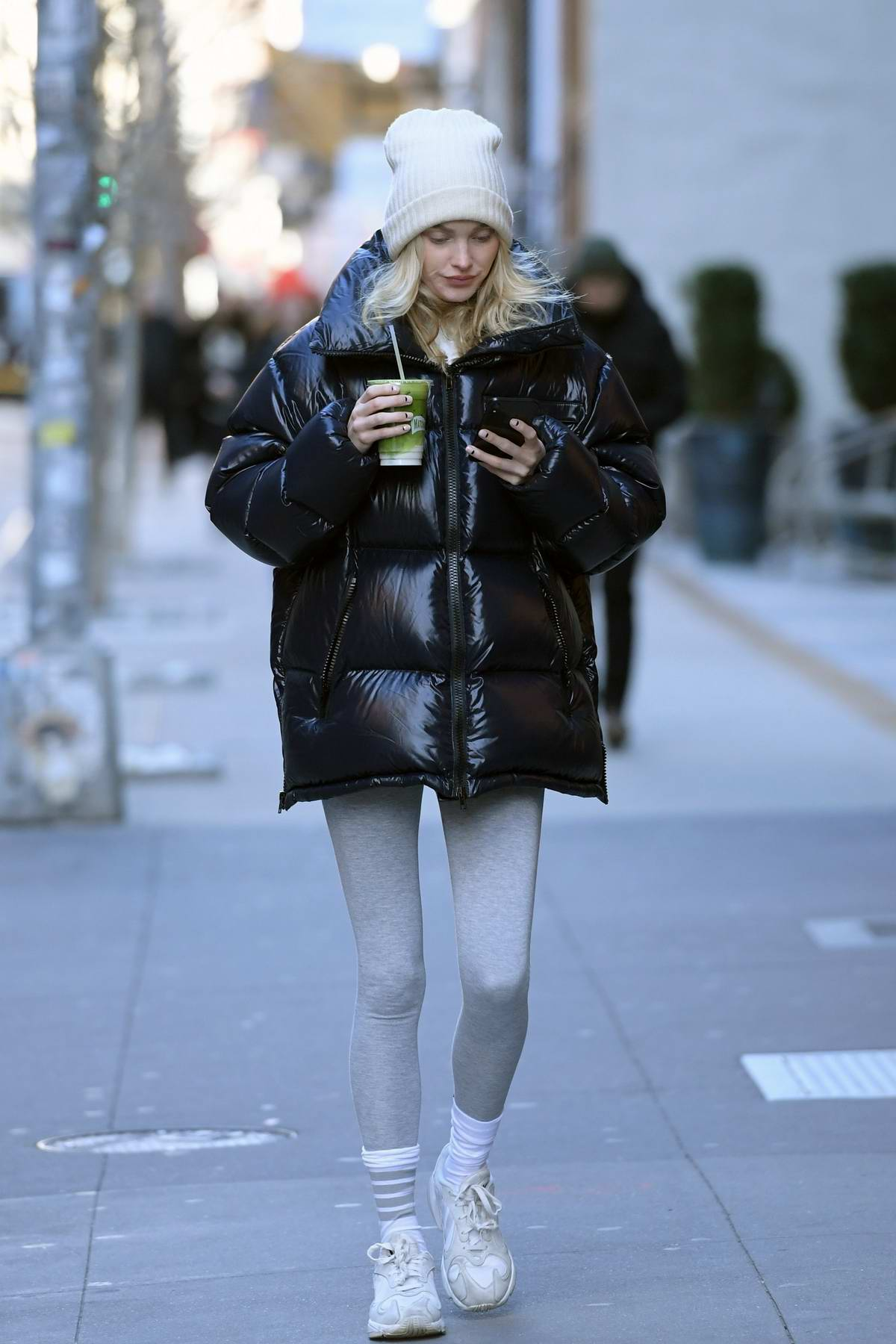 Elsa Hosk keeps warm in a puffer jacket and leggings as she steps out for a green juice in New York City