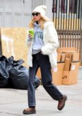 Elsa Hosk keeps warm in a white fur coat with matching beanie while out for a smoothie in SoHo, New York City