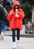 Emily Ratajkowski bundles up in a bright red puffer jacket for her morning coffee run in New York City