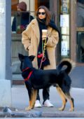 Emily Ratajkowski grabs a coffee while out to walk her dog Colombo in the Tribeca neighborhood in New York City