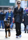 Emily Ratajkowski looks chic in a black leather coat while out walking her dog in New York City