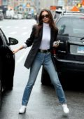 Emily Ratajkowski looks stylish in a black blazer paired with jeans and Nike trainers while out in New York City