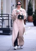 Emily Ratajkowski wears a trench coat as she steps out to run some errands in New York City