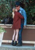 Emma Roberts and Garrett Hedlund pack on some PDA outside The Four Season Hotel in Beverly Hills, California