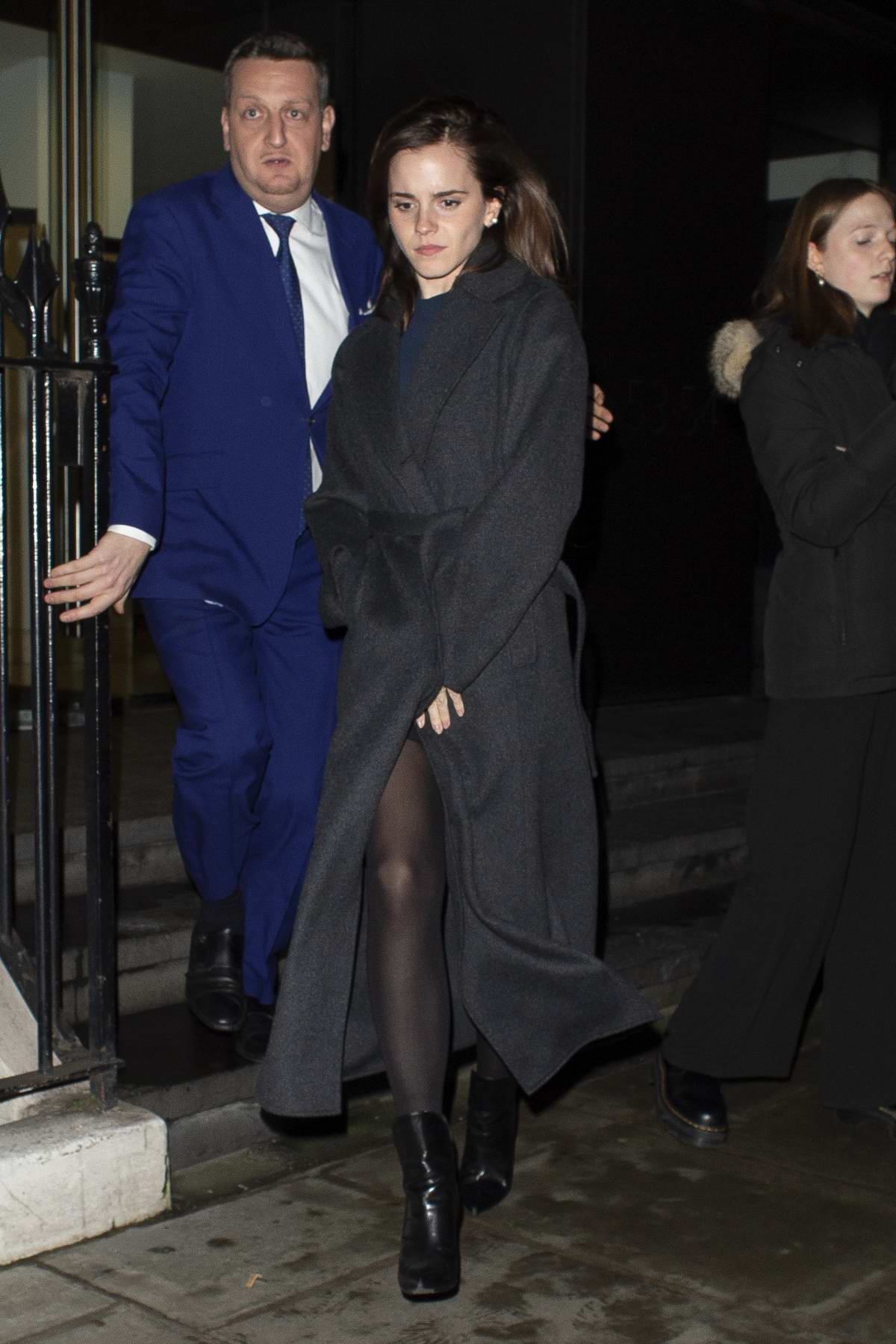 Emma Watson seen wearing a dark grey long coat as she leaves C restaurant in London, UK