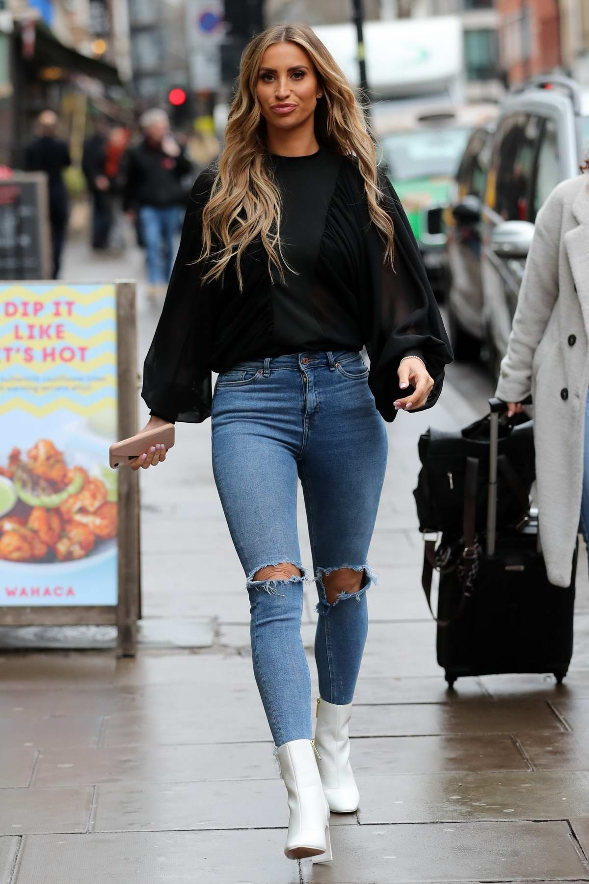 Ferne McCann wears a black top and skin-tight jeans while heading for a business meeting in Soho, London, UK