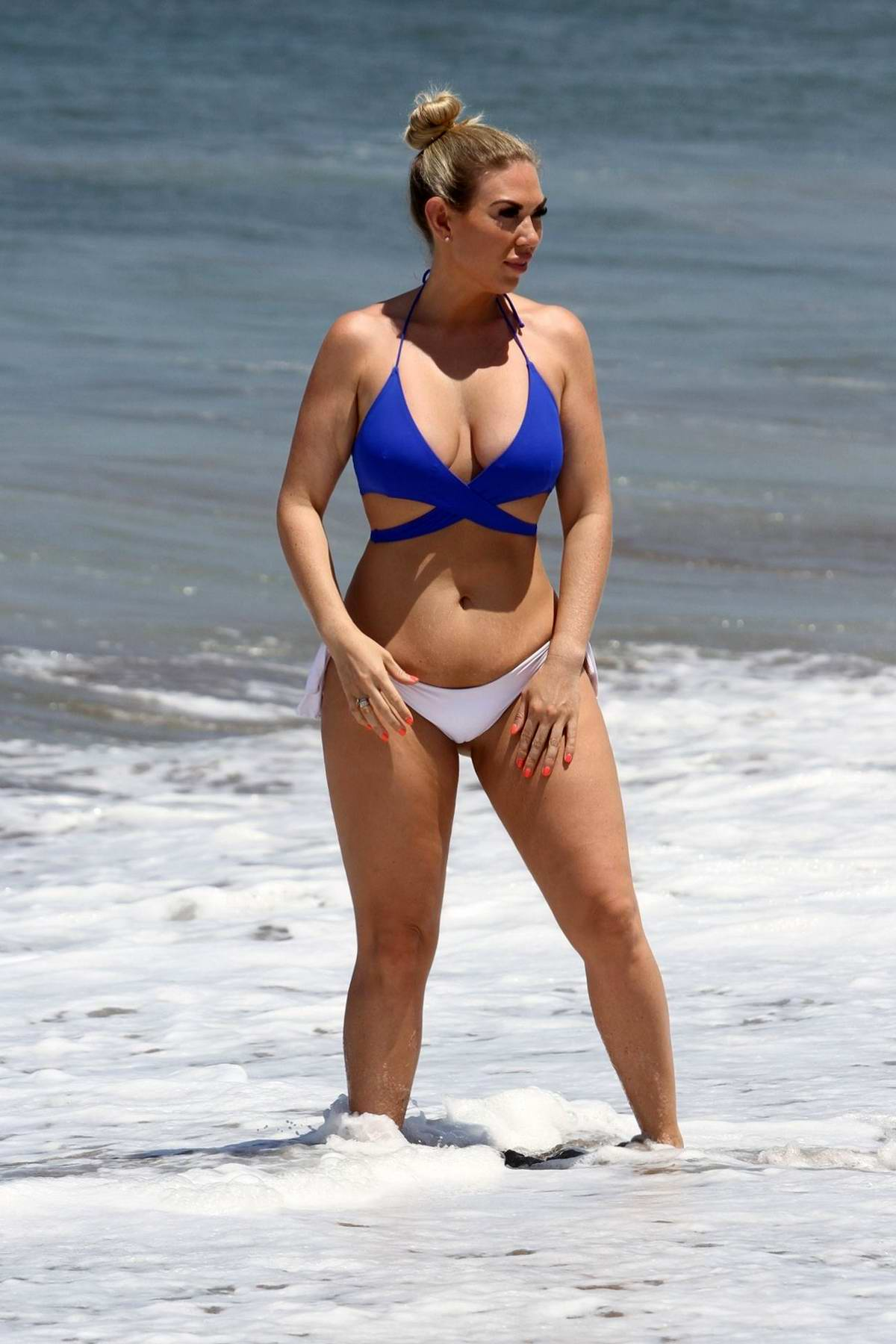 Frankie Essex seen wearing blue and white bikini at the beach while holidaying in Tenerife, Spain