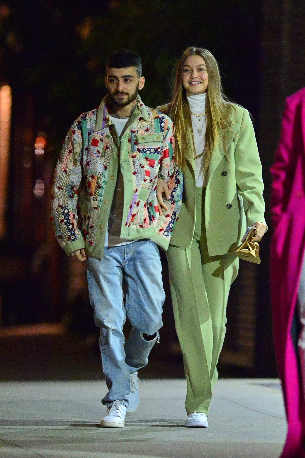 Gigi Hadid and Zayn Malik are all smiles as they step out for Zayn's birthday with Bella Hadid and Dua Lipa in New York City