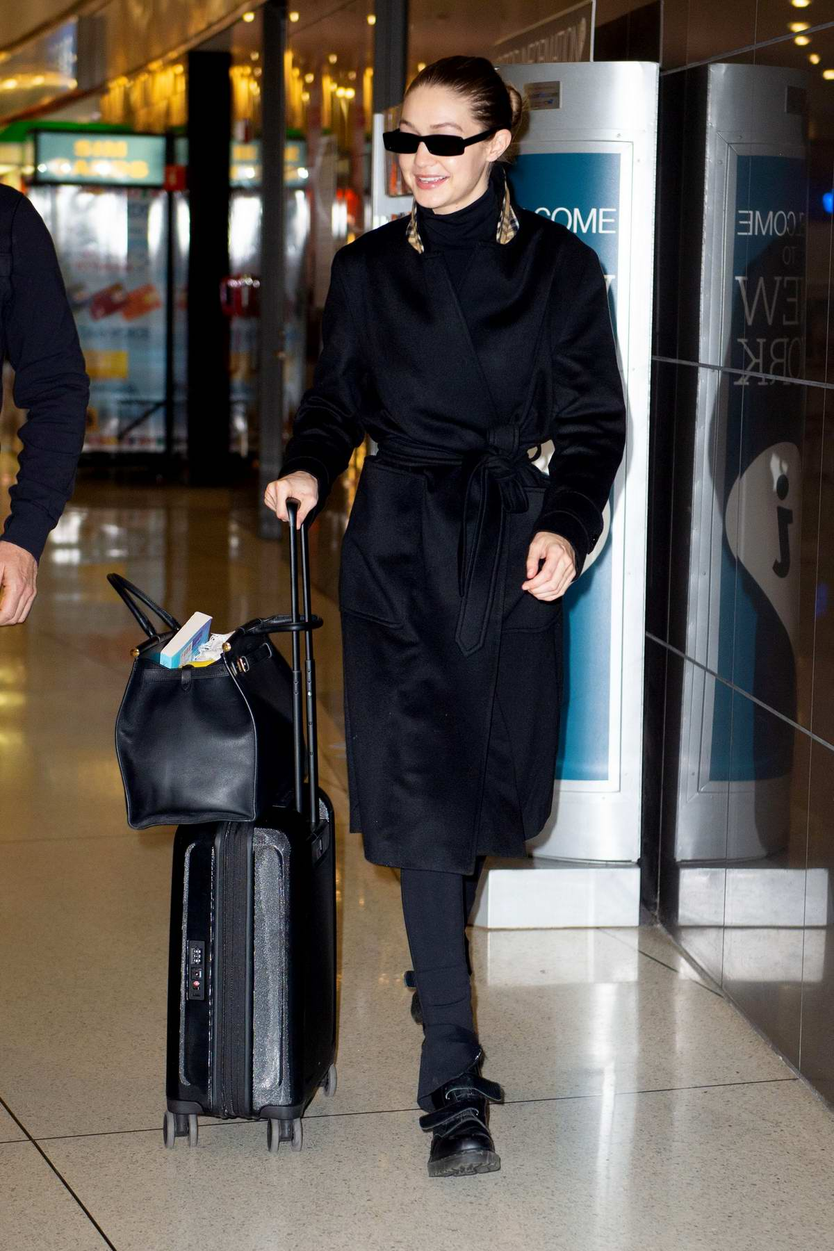 Gigi Hadid dons all black as she arrives at JFK airport in New York City