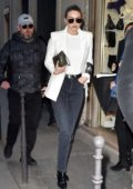 Gigi Hadid looks chic in white blazer with matching top and black denim as she heads to Chanel for Fittings in Paris, France