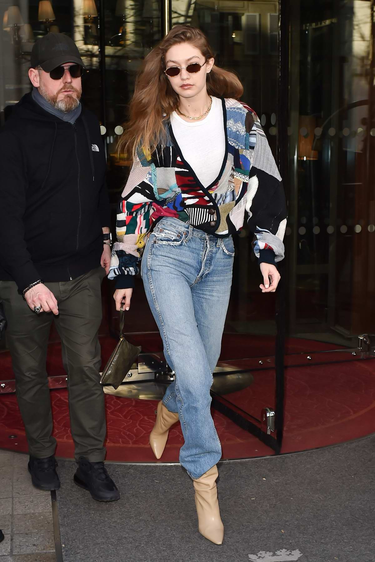Gigi Hadid makes a fashionable exit as she heads out for a Fashion Show in Paris, France