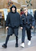 Hailey Bieber and Justin Bieber sport matching outfits while out for some shopping at the Grove in Los Angeles