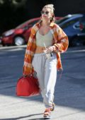 Hailey Bieber flaunts her flat abs as she hits up the dance studio in West Hollywood, California