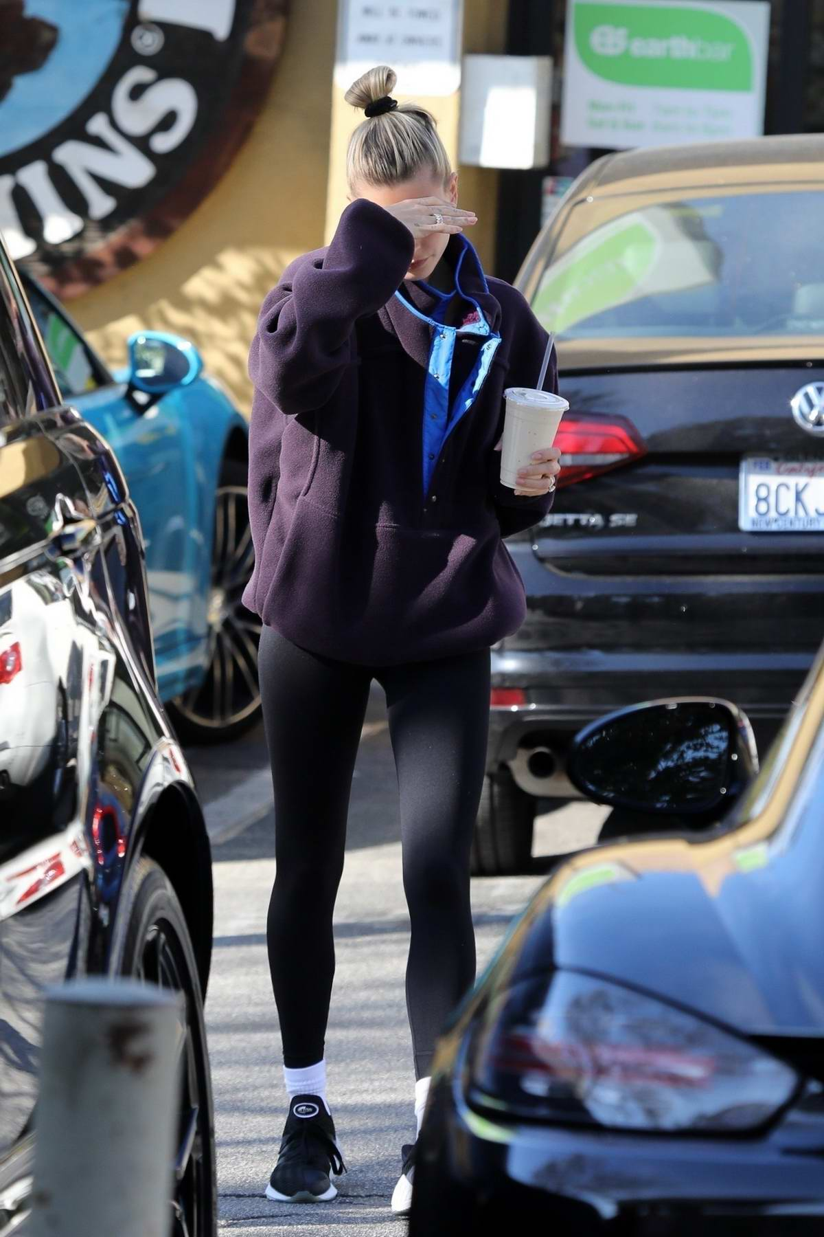 Hailey Bieber grabs a post-workout smoothie after a workout session at the Dogpound gym in Los Angeles