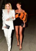 Hailey Bieber looks stunning in black and orange dress while leaving the YSL party in Los Angeles