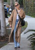 Hailey Bieber looks stylish in a beige long coat while out running errands in West Hollywood, California