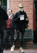 Hailey Bieber seen wearing black PVC pants and Balenciaga sneakers while out with a friend in Los Angeles
