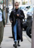 Hailey Bieber steps out wearing a leather long coat as she heads for lunch with a friend in West Hollywood, California