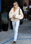 Hailey Bieber wears a teddy jacket and jeans while visiting Nine Zero One hair salon in West Hollywood, California