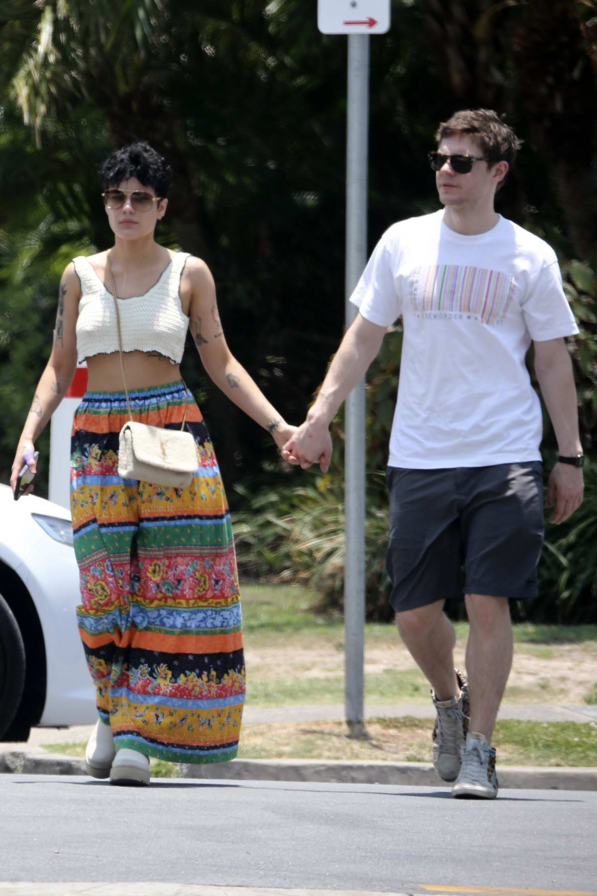 Halsey and Evan Peters step out holding hands as they head to lunch at Main Beach on the Gold Coast in Australia