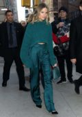 Halston Sage seen wearing a teal sweater with matching trousers as she visits Build Series in New York City