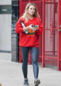 Hilary Duff seen wearing bright red Gucci sweatshirt and leggings as she leaves a gym in Los Angeles
