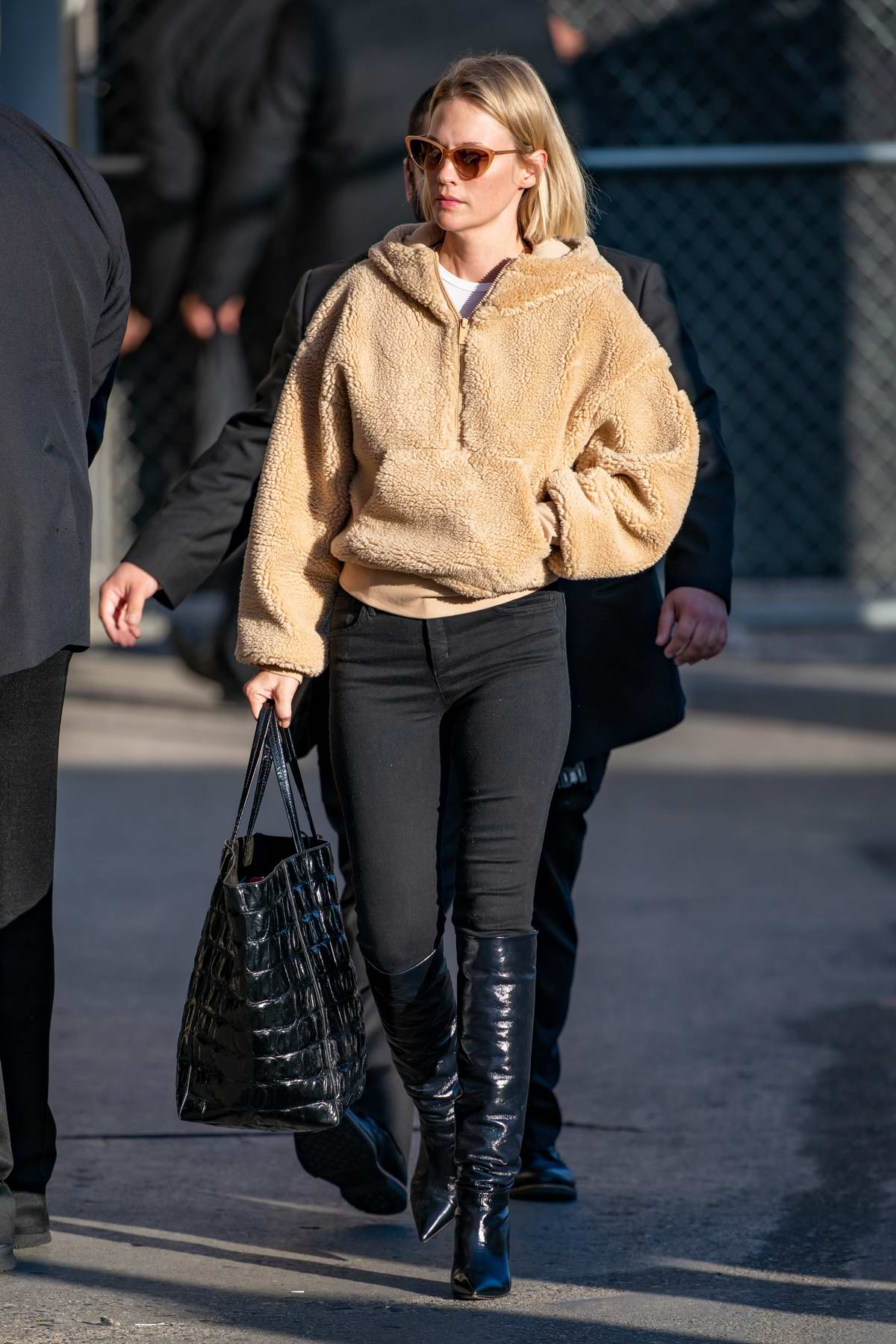 January Jones looks great in a beige teddy jacket and black skinny jeans as she arrives at 'Jimmy Kimmel Live' in Los Angeles