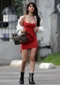 Jasmin Walia flaunts her legs in a red mini dress while visiting a studio in Los Angeles
